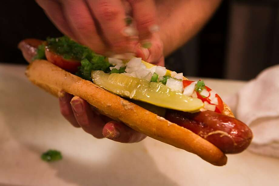 The Chicago Hot Dog being assembled at The Grill in San Francisco, Calif., on August 16th, 2011. Photo: John Storey, Special To The Chronicle