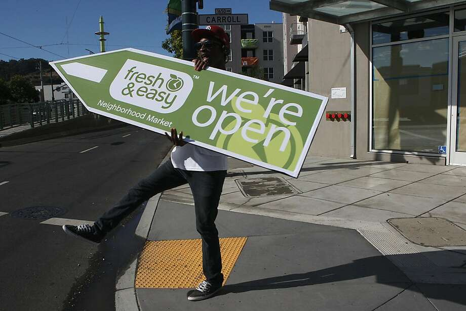 Fresh & Easy Neighborhood Market is the first new grocery store in Bayview-Hunters Point neighborhood to open in over 20 years in San Francisco, Calif., as a sign spinner advertises the market opening on Wednesday, August 24, 2011. Photo: Liz Hafalia, The Chronicle
