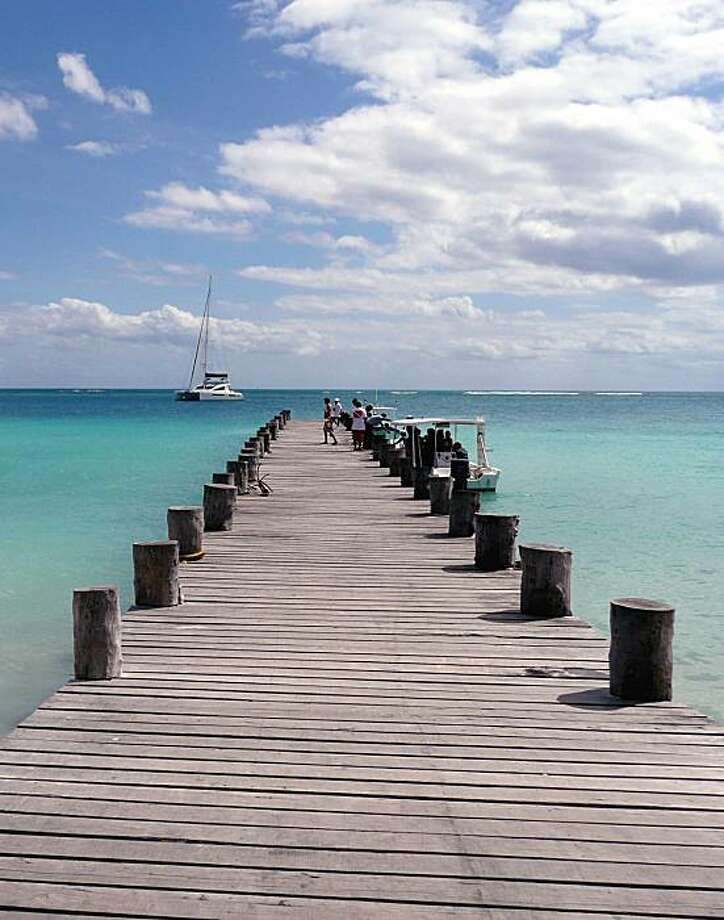 Puerto Morelos, Quintana Roo, Mexico -- The pier is hub of activity, just across the street from the town square. Photo: Christine Delsol, Special To The Chronicle