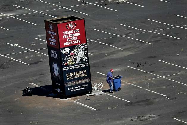 An employee cleaned up the Candlestick parking lot, where some of the violence occurred. A press briefing was held at Candlestick Park Monday August 22, 2011 to discuss the fan violence that erupted after the 49er-Raider game Saturday night. Photo: Brant Ward, The Chronicle