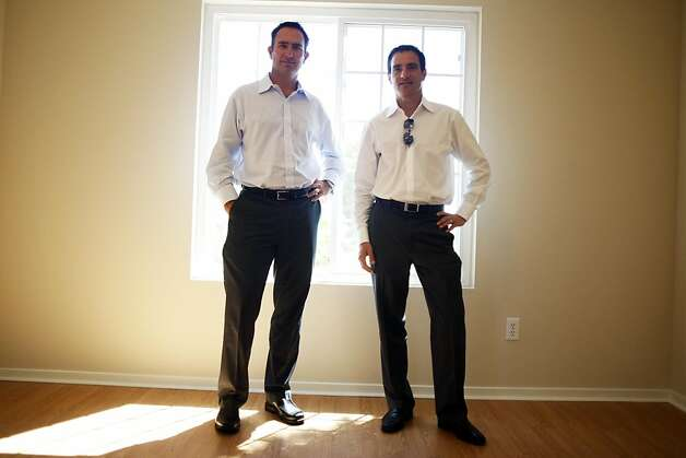 Doug Brien, left, and Colin Wiel, both managing directors of Waypoint Real Estate Group, stand in one of Waypoint's renovated homes on Monday, August 15, 2011.  Waypoint Homes buys foreclosed homes, fixes them up and rents them out with an option to buy. It owns about 700 homes in Contra Costa and Solano counties. Photo: Maddie McGarvey, The Chronicle