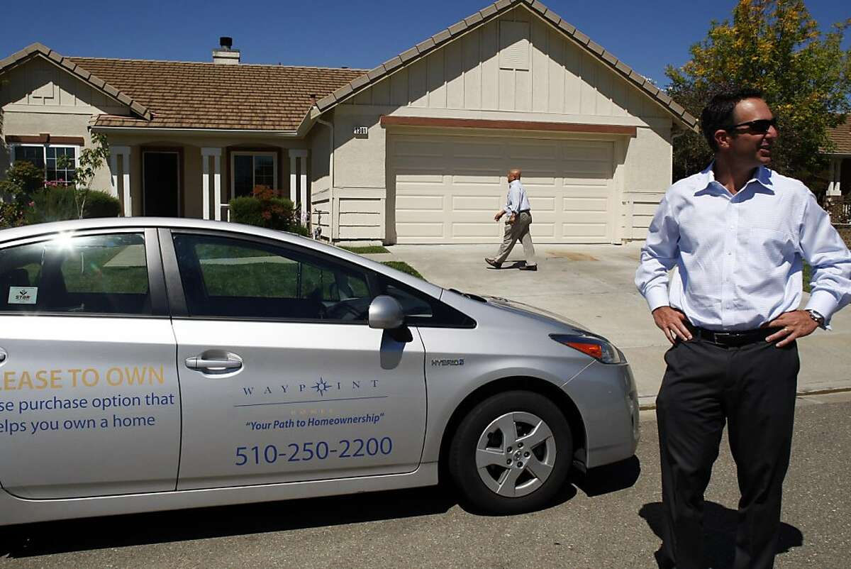 Doug Brien stands in front of a renovated home while Philip Zulueta, a leasing agent, walks towards the home on Monday, August 15, 2011. Waypoint Homes buys foreclosed homes, fixes them up and rents them out with an option to buy. It owns about 700 homes in Contra Costa and Solano counties.