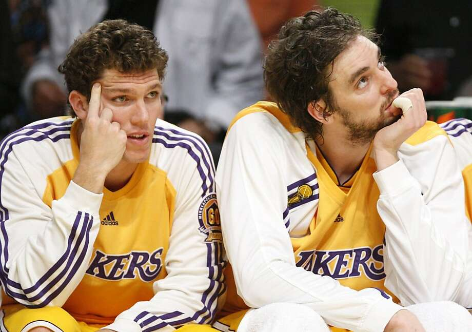 Los Angeles Lakers Luke Walton and Pau Gasol (R) sit on the bench while their team plays the Boston Celtics during the second half in Game 4 of the NBA Finals basketball championship in Los Angeles June 12, 2008.     REUTERS/Lucy Nicholson (UNITED STATES) Ran on: 06-13-2008 Luke Walton (left) and Pau Gasol are relegated to sideline observers during their team's loss. Photo: Lucy Nicholson, REUTERS
