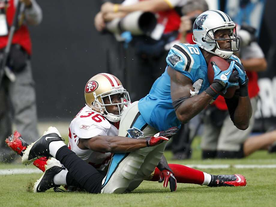 Carolina Panthers' David Gettis (12) catches a touchdown pass as San Francisco 49ers' Shawntae Spencer (36) defends during the second half of the Panthers' 23-20 win in an NFL football game in Charlotte, N.C., Sunday, Oct. 24, 2010. (AP Photo/Chuck Burton)  Ran on: 10-25-2010 Rookie receiver David Gettis had his biggest game of the year, catching eight passes for 125 yards and two touchdowns. Photo: Chuck Burton, AP