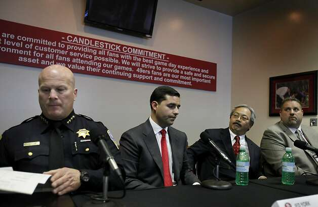 Police Chief Greg Suhr (left), 49er president Jed York, Mayor Ed Lee and stadium security chief Jim Mercurio (right) had a moment to themselves moments after the press conference ended. A press briefing was held at Candlestick Park Monday August 22, 2011 to discuss the fan violence that erupted after the 49er-Raider game Saturday night. Photo: Brant Ward, The Chronicle