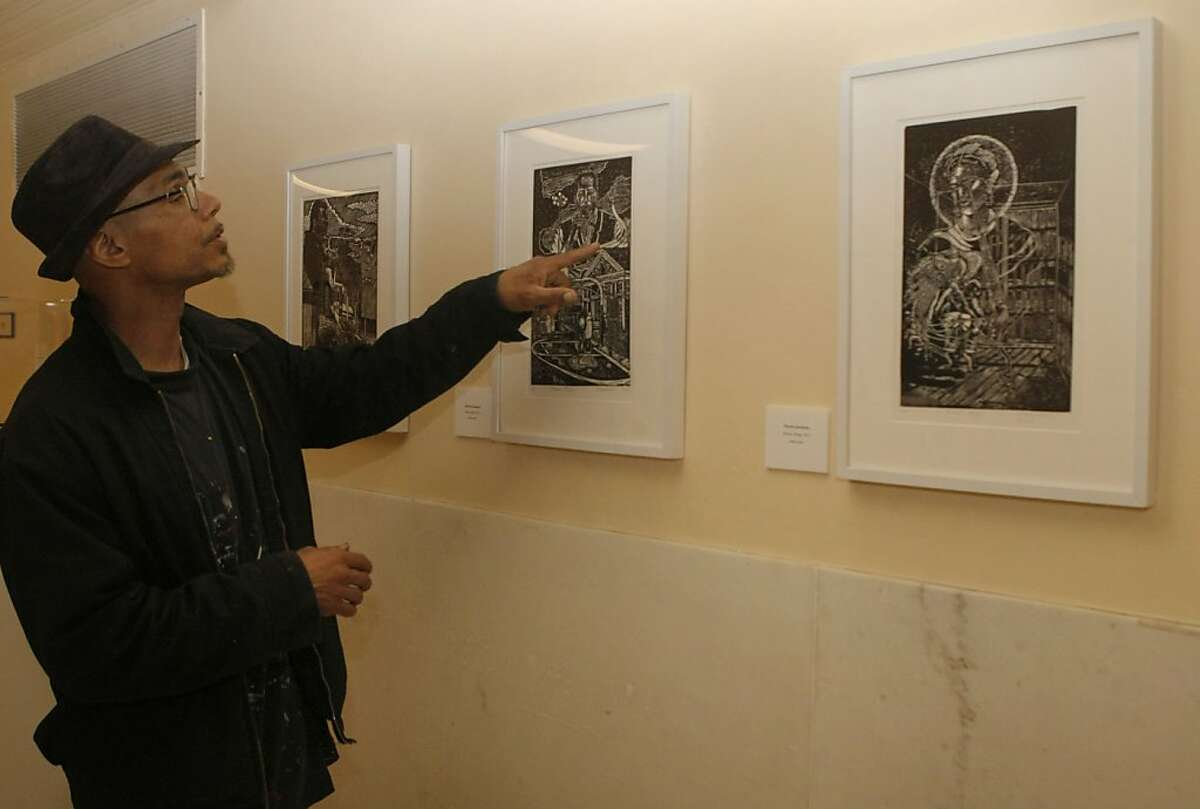 """Ronnie Goodman points to one of his block prints called """"Folsom Blues, 2011"""" that is displayed in San Francisco City Hall in San Francisco Calif., on August 10, 2011. Goodman learned block printing while serving a 10 year sentence in San Quentin for first degree burglary."""