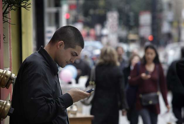 Ryan Perez of San Francisco sends a text on his cell phone on Thursday, February 18, 2010, in San Francisco, Calif. State Sen. Mark Leno is introducing a bill designed to give consumers more information about how much radiation their cell phones emit. Photo: Lea Suzuki, Special To The Chronicle