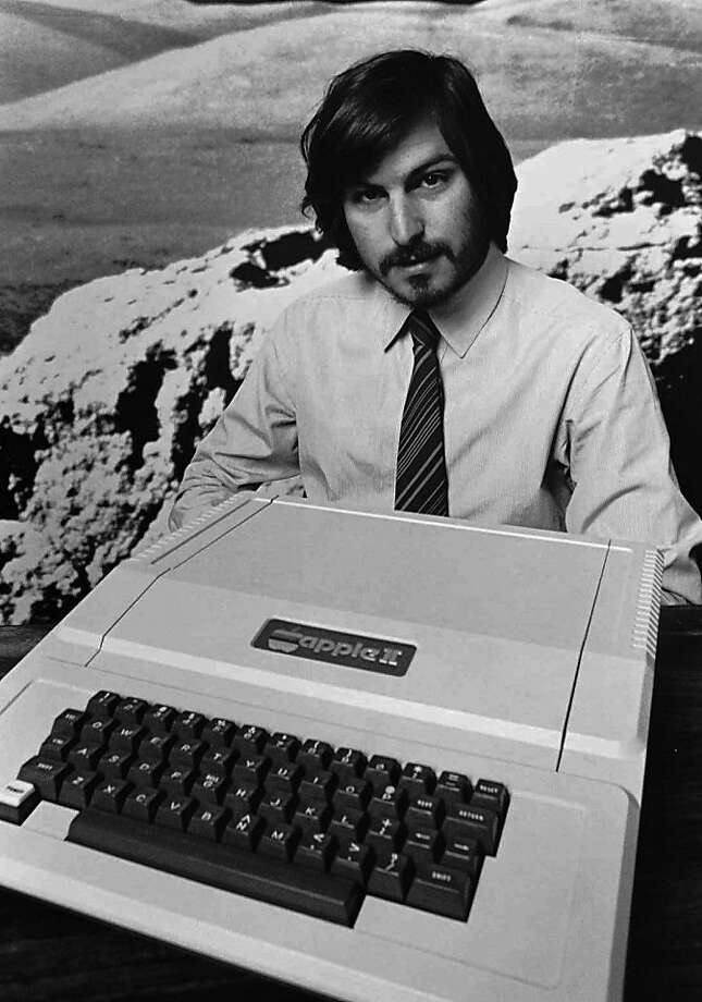 This is a 1977 photo of Apple Computer Inc. founder Steve Jobs as he introduces the new Apple II in Cupertino, Calif. Apple Computer was formed 20 years ago, on April Fool's Day in 1976.  This is a 1977 photo of Apple Computer Inc. founder Steve Jobs as he introduces the new Apple II in Cupertino, Calif. Apple Computer was formed 20 years ago, on April Fool's Day in 1976.  (AP Photo/Apple Computers Inc., file)  Ran on: 01-09-2006 Ran on: 03-26-2006 Apple co-founder Steve Jobs introduces the new Apple II computer in Cupertino. Photo: Apple Computer, Inc., AP