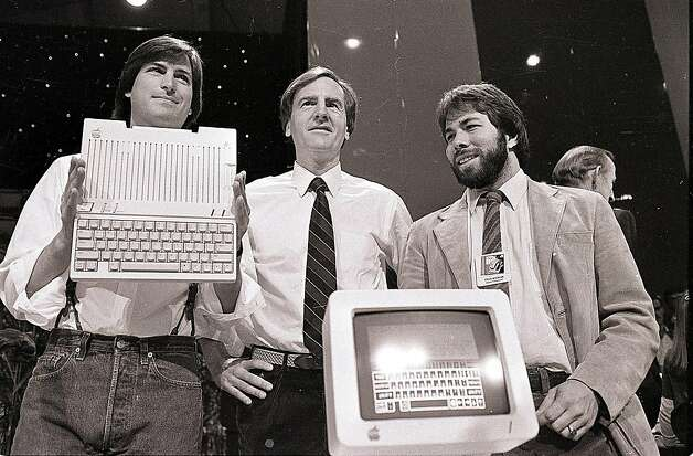 In this April 24, 1984 file photo, Steve Jobs, left, chairman of Apple Computers, John Sculley, center, then president and CEO, and Steve Wozniak, co-founder of Apple, unveil the new Apple IIc computer in San Francisco. Apple Inc. on Wednesday, Aug. 24, 2011 said Jobs is resigning as CEO, effective immediately. He will be replaced by Tim Cook, who was the company's chief operating officer. It said Jobs has been elected as Apple's chairman. Photo: Sal Veder, AP