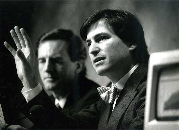 John Sculley (left) and Steve Jobs of Apple Computers speak at a press conference following the annual shareholders meeting on Jan. 23, 1985. Photo: Chris Stewart, The Chronicle