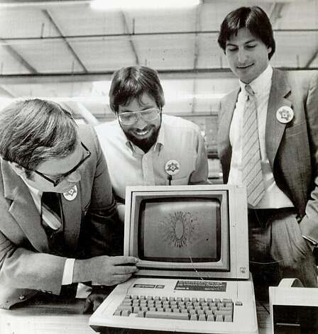"Apple Computer, Inc., announced the start of the first shipment of 9,000 computers to virtually every school in the state of California in a massive giveaway aimed at promoting ""computer literacy"" in the primary and secondary schools. The first and millionth produced were given to the Sunnyvale School District. Owen Whetzel, president of the school board, left, takes a close look at the computer. Steve Wozniak, co-founder, center,  and Steve Jobs, Chairman of the board of Apple Computer, Inc. is at right.  Photo: Courtesy, UPI 1983"