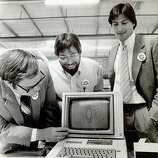 "Apple Computer, Inc., announced the start of the first shipment of 9,000 computers to virtually every school in the state of California in a massive giveaway aimed at promoting ""computer literacy"" in the primary and secondary schools. The first and millionth produced were given to the Sunnyvale School District. Owen Whetzel, president of the school board, left, takes a close look at the computer. Steve Wozniak, co-founder, center,  and Steve Jobs, Chairman of the board of Apple Computer, Inc. is at right."