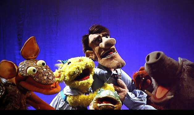 "Muppet audience is treated to two shows in one, the first show offers two large screens so you can view the performance much like a movie, the other is watching the performers do their magic with the Muppets on stage. Henson puppets in ""Stuffed and Unstrung"" is now playing at the Curran Theatre, offering standup comedy only the Muppets/puppets can do Thursday August 18, 2011 Photo: Lance Iversen, The Chronicle"