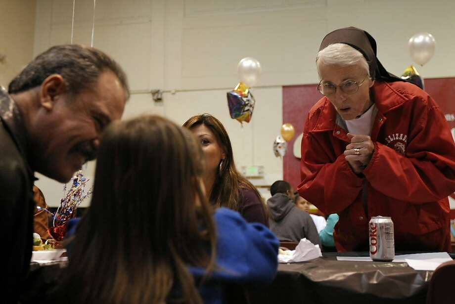 Sister Mary Liam Brock (right) talks with Cecilia Serna (center left), 3, Jose Padilla (far left) and Arasely Padilla (center right), during a graduating senior luncheon at St. Elizabeth High School in Oakland, Calif., on Wednesday, May 25, 2011. Photo: Thomas Levinson, The Chronicle