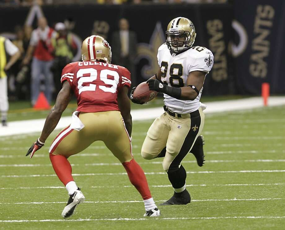 New Orleans Saints running back Mark Ingram (28) and San Francisco 49ers cornerback Chris Culliver (29) during an NFL preseason football game at the Louisiana Superdome in New Orleans, Friday, Aug. 12, 2011. (AP Photo/Bill Haber) Photo: Bill Haber, AP