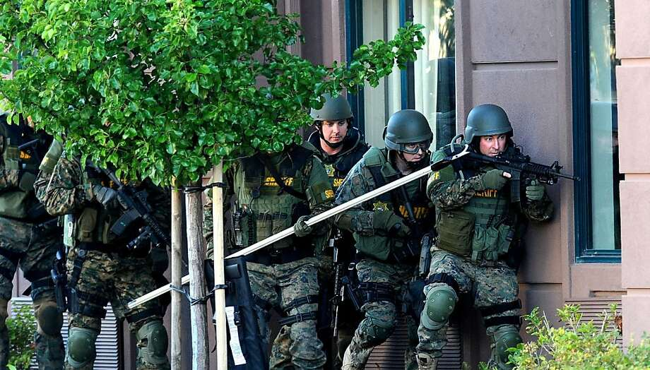Police stage outside an Extended Stay Hotel during a standoff on Wednesday, Aug. 17, 2011, in San Rafael, Calif. A gunman, who police suspect of a stabbing last Sunday, had barricaded himself in a room. Photo: Noah Berger, Special To The Chronicle