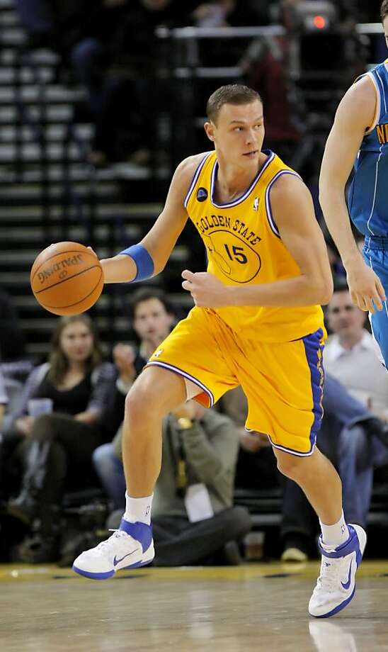 Andris Biedrins dribbles down the court after a defensive rebound in the second half. The Golden State Warriors played the New Orleans Hornets at Oracle Arena on Tuesday, February 15, 2011 in Oakland, Calif. Photo: Carlos Avila Gonzalez, The Chronicle