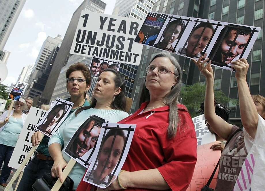 Laura Fattal, left, Cindy Hickey, center, and Nora Shourd, mothers of three American hikers jailed in Iran, participate in a demonstration outside Iran's mission to the United Nations, in New York,  Friday, July 30, 2010. Saturday marks a year since the hikers were arrested along the Iraqi border. (AP Photo/Richard Drew) Ran on: 07-31-2010 Laura Fattal (left) Cindy Hickey (center) and Nora Shourd, mothers of three U.S. hikers jailed in Iran, rally in New York. Photo: Richard Drew, AP