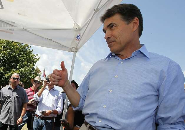 Republican presidential candidate Texas Gov. Rick Perry gives a thumbs up as ...