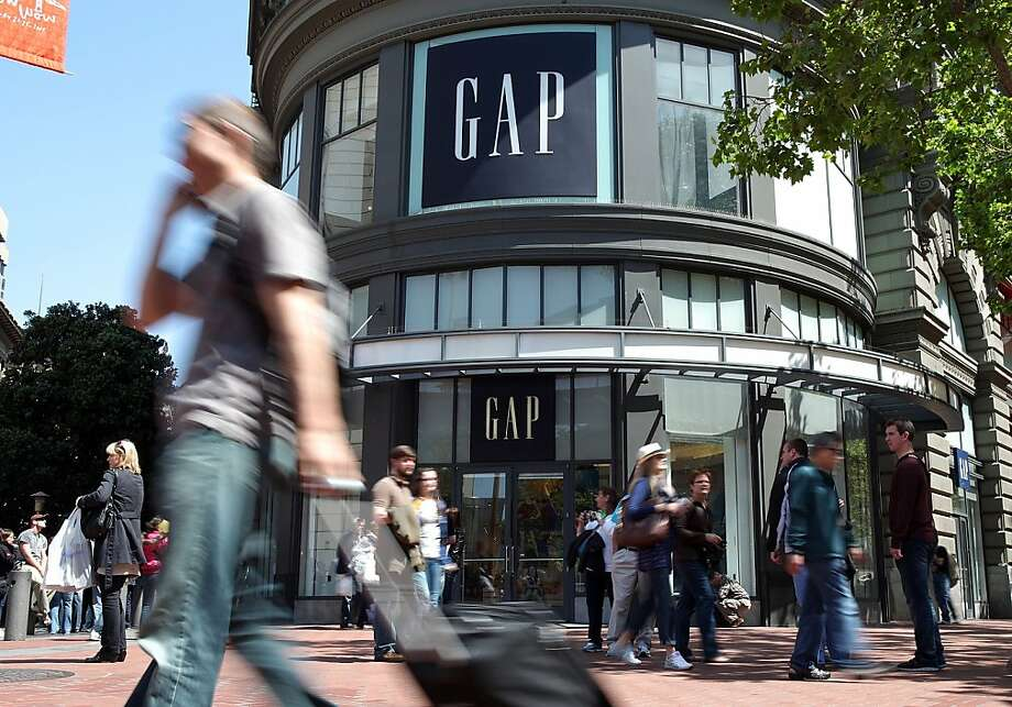 SAN FRANCISCO, CA - MAY 19:  Pedestrians walk by a Gap store on May 19, 2011 in San Francisco, California. Clothing retailer Gap Inc. will announce first quarter earnings today after the stock market close.  (Photo by Justin Sullivan/Getty Images)  Ran on: 05-21-2011 Gap reported quarterly profit that fell from a year earlier, but its online revenue was up. Photo: Justin Sullivan, Getty Images