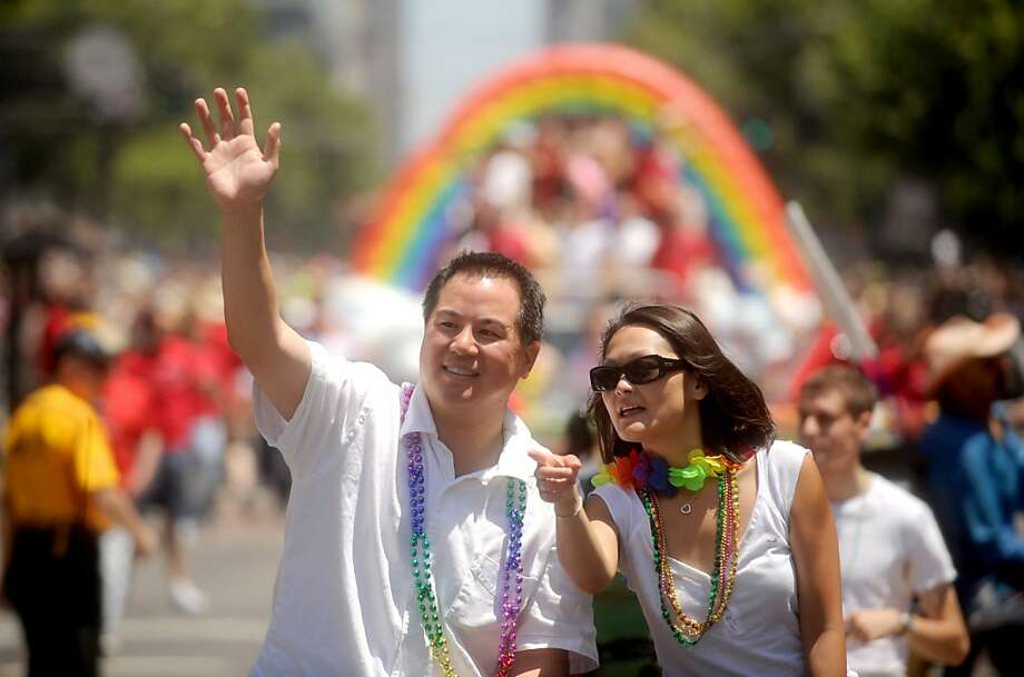 Phil Ting, San Francisco assessor-recorder and Supervisor Carmen Chu wave during the Pride Parade on Sunday, June 28, 2009, in San Francisco.  Ran on: 01-22-2011 Phil Ting sent an e-mail lamenting the city's push to issue more tickets for parking.  Ran on: 04-03-2011 Phil Ting Photo: Noah Berger, Special To The Chronicle