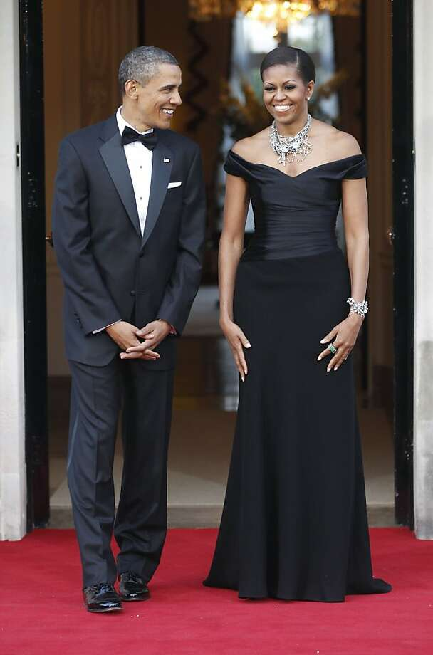 This Wednesday, May 25, 2011 file photo shows U.S. President Barack Obama and first lady Michelle Obama as they wait to welcome Britain's Queen Elizabeth II and Prince Philip for a reciprocal dinner at Winfield House in London.  Photo: Charles Dharapak, AP