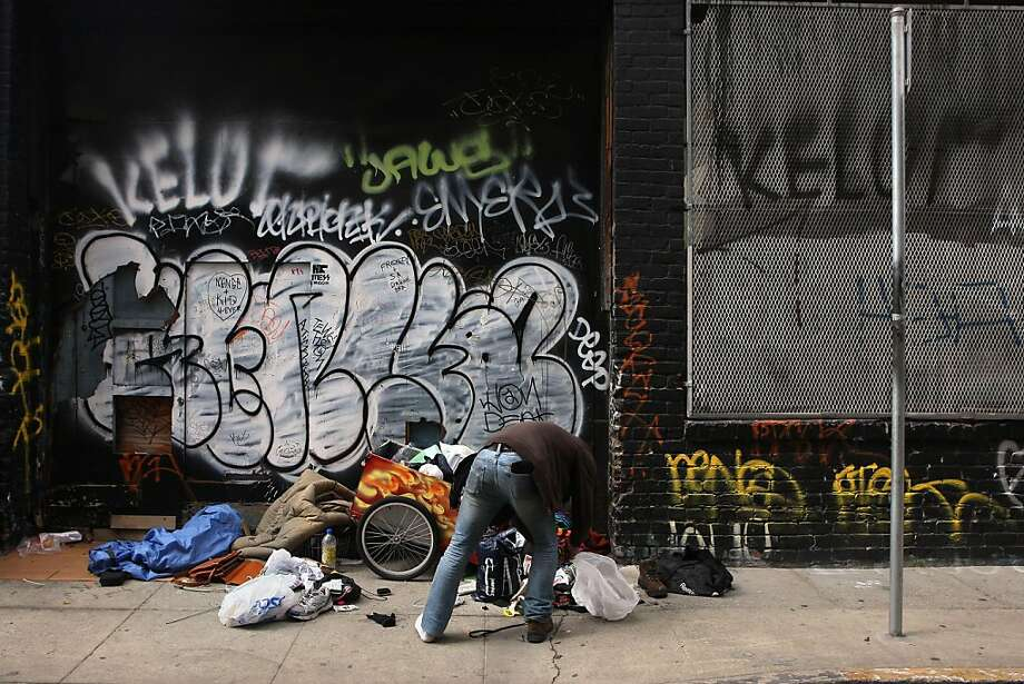 A homeless man looking for his shoe on Lech Walesa St. in San Francisco, Calif., on Thursday, August 18, 2011.  What prompts people to move out of San Francisco? Photo: Liz Hafalia, The Chronicle