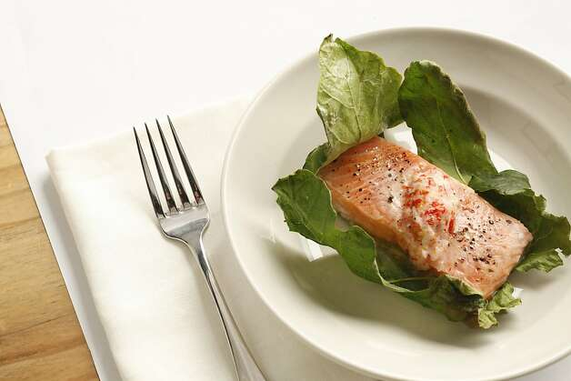 Wild King Salmon in Fig Leaves as seen in San Francisco, California, on Wednesday, July 27, 2011.  Food styled by Lynne Char Bennett. Photo: Craig Lee, Special To The Chronicle