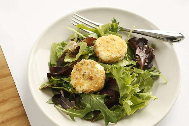 Baked goat cheese with garden lettuces as seen in San Francisco, California, on Wednesday, July 27, 2011.  Food styled by Rochelle Vurek Photo: Craig Lee, Special To The Chronicle