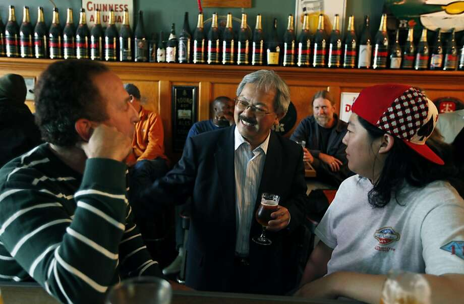 Mayor Ed Lee center talks with Dan Burk, left, and Scott Shimoda, both from San Francisco, during his tour of the lower Haight neighborhood on a pub- crawl Thursday August 18, 2011. Photo: Lance Iversen, The Chronicle