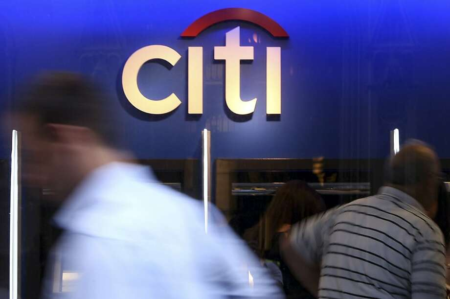 FILE PHOTO:  Pedestrians pass a Citigroup Inc. bank branch in New York, U.S., on Friday, July 16, 2010. The biggest borrowers under seven U.S. Federal Reserve emergency-lending programs were Morgan Stanley, Citigroup Inc., and Bank of America Corp. The three banks' combined $298.2 billion in hidden Fed loans was triple what they received in publicly disclosed bailouts from the U.S. Treasury. Photographer: Jin Lee/Bloomberg Photo: Jin Lee, Bloomberg