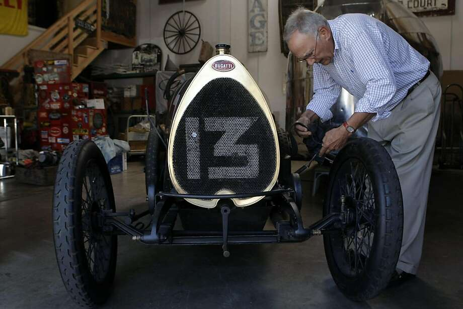 Dr. Leo Keoshian unstraps the engine cover on his restored 1920 Brescia Bugatti to get the car ready for a quick spin in Redwood City Calif.,  on August 9, 2011. This rare French sports car was originally brought to the US from France by an American serviceman after WWII and was later sold to a Japanese collector from whom Dr. Keoshian bought the car 12 years ago. Photo: Audrey Whitmeyer-Weathers, The Chronicle
