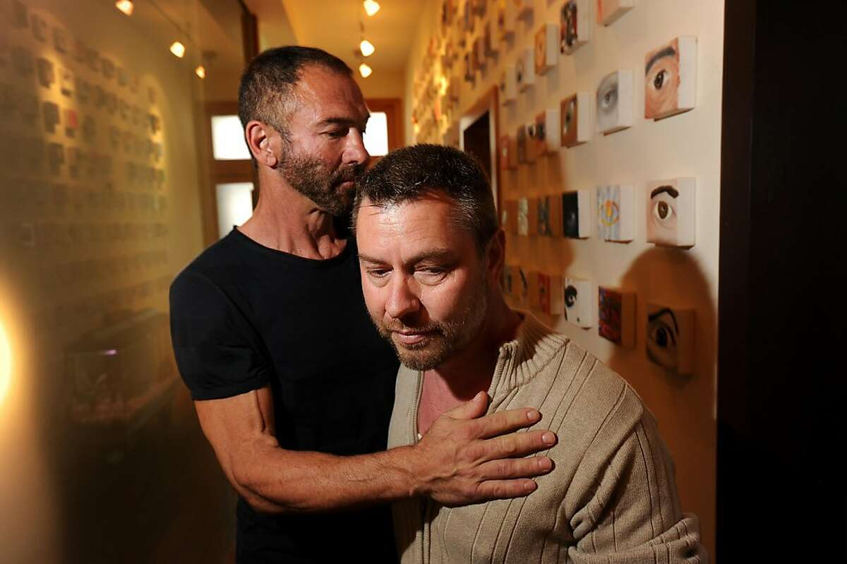 Anthony Makk, right, spends time with husband Bradford Wells on Monday, Aug. 8, 2011, at their San Francisco home. Though legally married in 2004, Makk faces deportation back to his native Australia.