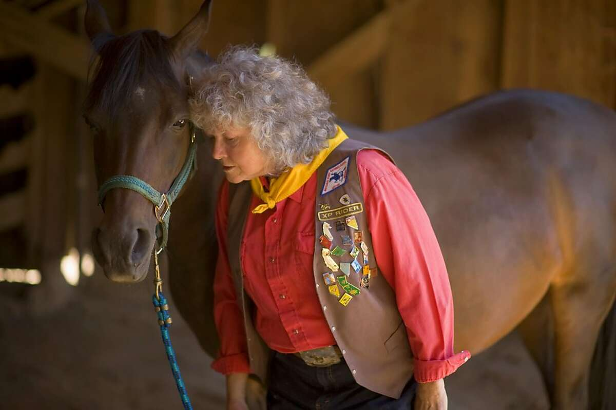 Melba Ray-Leal with her horse Allie, at her Placerville home, Sunday Aug 7, 2011. Ray-Leal is a member of the National Pony Express Association, a group of 800+ people who reenact the Pony Express each summer. Ray-Leal, who was instrumental in including women in the organization. She hopes to ride again next year.