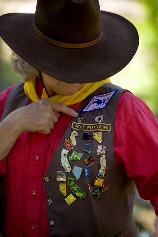 Melba Ray-Leal displays her pins including her lifetime pin, at her Placerville home, Sunday Aug 7, 2011. Ray-Leal is a member of the National Pony Express Association, a group of 800+ people who reenact the Pony Express each summer. Ray-Leal, who was instrumental in including women in the organization. She hopes to ride again next year. Photo: Brian Baer, Special To The Chronicle
