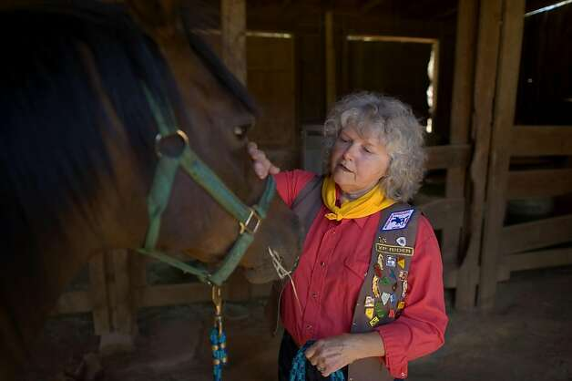 Melba Ray-Leal with her horse Allie, at her Placerville home, Sunday Aug 7, 2011. Ray-Leal is a member of the National Pony Express Association, a group of 800+ people who reenact the Pony Express each summer. Ray-Leal, who was instrumental in including women in the organization. She hopes to ride again next year. Photo: Brian Baer, Special To The Chronicle