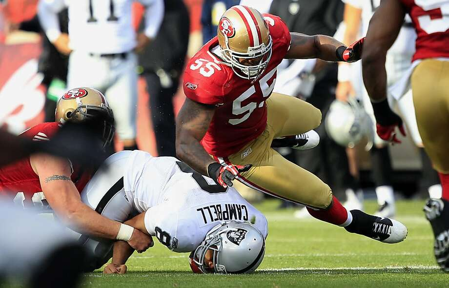 Oakland Raiders quarterback Jason Campbell (8) is tackled by San Francisco 49ers defensive tackle Justin Smith, left, as linebacker Ahmad Brooks (55) lands on him in the first half of a preseason NFL football game in San Francisco, Saturday, Aug. 20, 2011. (AP Photo/Marcio Jose Sanchez) Photo: Marcio Jose Sanchez, AP