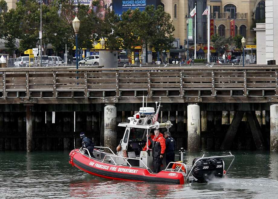A San Francisco Fire Department boat searched the area around Pier 39 for a missing man, last seen in a canoe, Thursday August 18, 2011. Photo: Brant Ward, The Chronicle