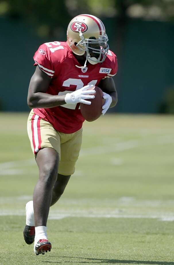 The San Francisco 49ers running back Frank Gore works out with his team for the first time since being injured last year, Tuesday August 2, 2011, in Santa Clara, Calif. Photo: Lacy Atkins, The Chronicle