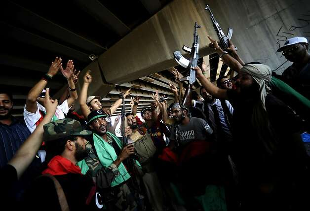 Libyan rebels celebrate as they gain positions against regime forces in the city of Zawiya, some 40 kms west of Tripoli, on August 19, 2011. Libyan rebels claimed to have taken two more key objectives in their advance on Tripoli, including the refinery town of Zawiya, as people scrambled to flee the increasingly isolated capital. AFP PHOTO / FILIPPO MONTEFORTE (Photo credit should read FILIPPO MONTEFORTE/AFP/Getty Images) Photo: Filippo Monteforte, AFP/Getty Images