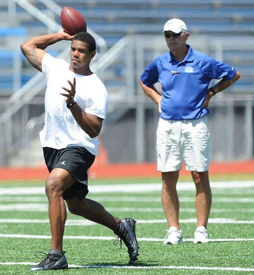 In this photo photo Friday, Aug. 12, 2011, former Ohio State quarterback works out as quarterback coach Ken Anderson looks on at Hempfield Area High School near Jeannette, Pa. The NFL announced Thursday, Aug. 18, 2011, that Pryor is eligible for its supplemental draft, but he won't be allowed to practice for the team that selects him until Week 6. (AP Photo/Post-Gazette, Barry Reeger)  MAGS OUT; NO SALES; MONESSEN OUT; KITTANNING OUT; CONNELLSVILLE OUT; GREENSBURG OUT; TARENTUM OUT; NORTH HILLS NEWS RECORD OUT; BUTLER OUT Photo: Barry Reeger, AP