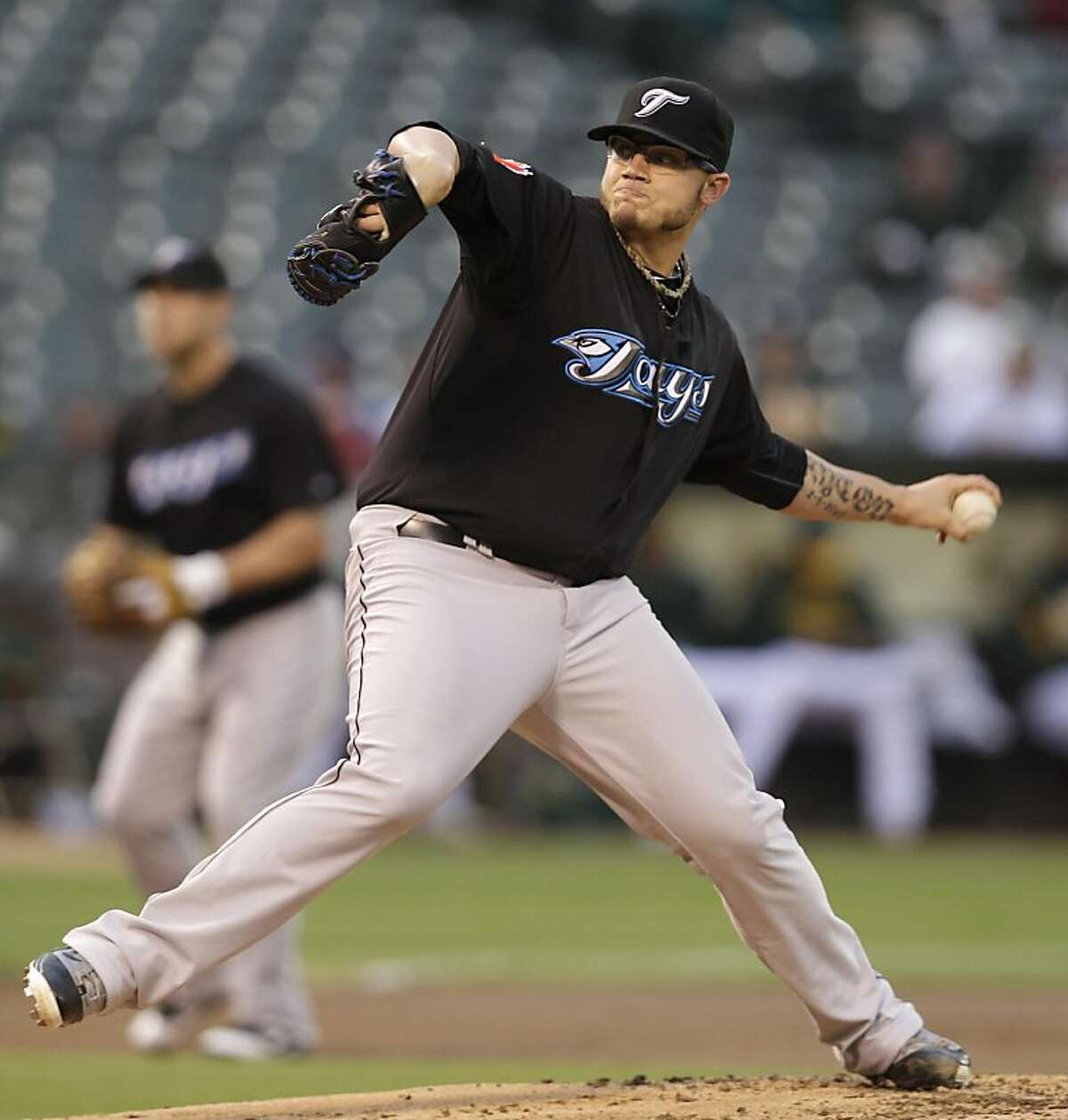 Toronto Blue Jays' Brett Cecil works against the Oakland Athletics during the first inning of a baseball game, Friday, Aug. 19, 2011, in Oakland, Calif. (AP Photo/Ben Margot)