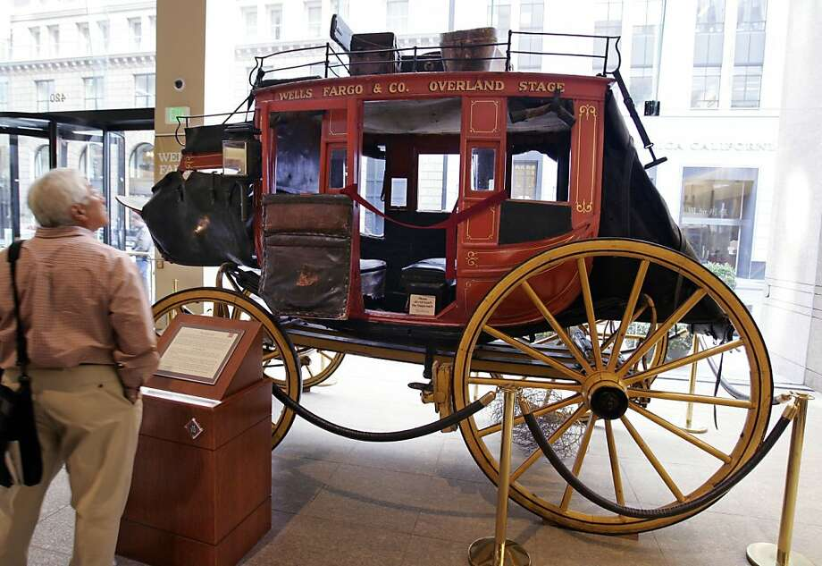 An original Wells Fargo stagecoach is shown at Wells Fargo headquarters in San Francisco, Wednesday, Oct. 15, 2008. Wells Fargo said Wednesday, Oct. 15, 2008, third-quarter profit fell 23 percent as it took losses on investments in troubled financial companies. Results, however, topped analysts expectations. (AP Photo/Paul Sakuma) Ran on: 10-16-2008 An original Wells Fargo stagecoach is on display at the bank's headquarters in San Francisco's Financial District. Ran on: 10-16-2008 Photo: Paul Sakuma, AP