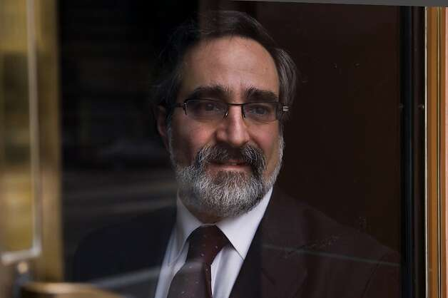 Outgoing San Francisco Board of Supervisors President Aaron Peskin looks out the front door of his office building in San Francisco's North Beach on Wednesday, Dec. 31, 2008. Ran on: 01-03-2009 Aaron Peskin, on North Beach's Green Street, has written and won approval for 205 ordinances in his eight years on the board. Photo: Kim Komenich, The Chronicle