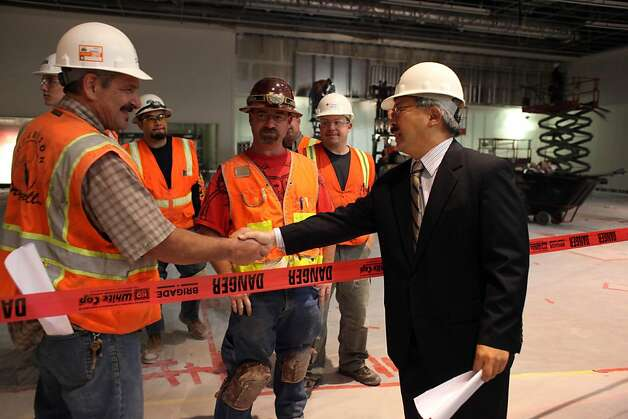 Mayor Ed Lee (right) shakes the hands with Martin Maffioli, Harrison Drywall drywall foreman and other workers while taking a tour of the $56 million renovations at Moscone Center on Thursday, August 11, 2011 in San Francisco, Calif. Photo: Lea Suzuki, The Chronicle