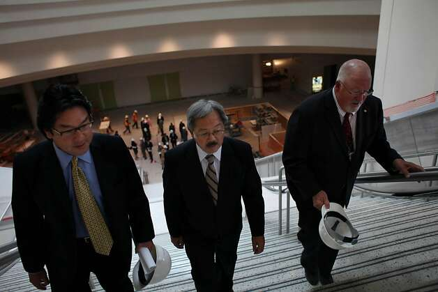 John Noguchi, Director of Convention Facilities (l to r), Mayor Ed Lee and Dick Shaff, Vice President and General Manager of Moscone Center, walk up the stairs from the lower North lobby during a tour of the $56 million renovations at Moscone Center on Thursday, August 11, 2011 in San Francisco, Calif. Photo: Lea Suzuki, The Chronicle