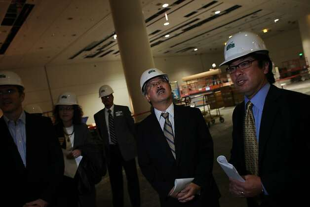 Mayor Ed Lee surveys the work being done while taking a tour of the $56 million renovations at Moscone Center on Thursday, August 11, 2011 in San Francisco, Calif. Photo: Lea Suzuki, The Chronicle