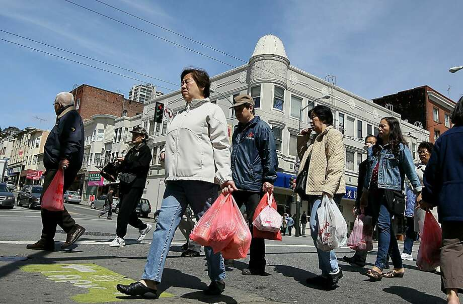 SAN FRANCISCO - JUNE 02:  Pedestrians carry plastic grocery bags as they cross the street June 2, 2010 in San Francisco, California. California may become the first state in the nation to ban plastic bags from grocery and convenience stores. In addition to the ban, consumers would be charged 5 cents per paper bag if they do not bring their own reusable bags. Assembly bill AB1998 is supported by Gov. Arnold Schwarzengger and is expected to pass an assembly vote this week before moving to the State Senate for a vote later this year.  (Photo by Justin Sullivan/Getty Images)  Ran on: 06-08-2010 Photo caption Dummy text goes here. Dummy text goes here. Dummy text goes here. Dummy text goes here. Dummy text goes here. Dummy text goes here. Dummy text goes here. Dummy text goes here.###Photo: edit08_plastic_PH1275350400Getty Images North America###Live Caption:SAN FRANCISCO - JUNE 02:  Pedestrians carry plastic grocery bags as they cross the street June 2, 2010 in San Francisco, California. California may become the first state in the nation to ban plastic bags from grocery and convenience stores. In addition to the ban, consumers would be charged 5 cents per paper bag if they do not bring their own reusable bags. Assembly bill AB1998 is supported by Gov. Arnold Schwarzengger and is expected to pass an assembly vote this week before moving to the State Senate for a vote later this year.###Caption History:SAN FRANCISCO - JUNE 02:  Pedestrians carry plastic grocery bags as they cross the street June 2, 2010 in San Francisco, California. California may become the first state in the nation to ban plastic bags from grocery and convenience stores. In addition to the ban, consumers would be charged 5 cents per paper bag if they do not bring their own reusable bags. Assembly bill AB1998 is supported by Gov. Arnold Schwarzengger and is expected to pass an assembly vote this week before moving to the State Senate for a v Photo: Justin Sullivan, Getty Images