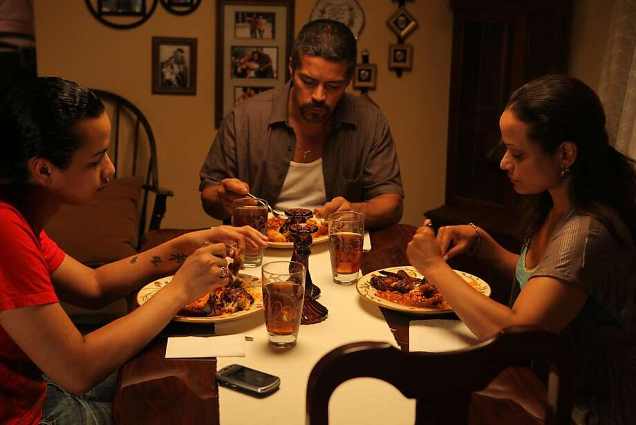 "Harmony Santana, left, Esai Morales, Judy Reyes appear in a scene from, ""Gun Hill Road.""   Ran on: 08-12-2011 Harmony Santana (left) portrays the son who is becoming the daughter to parents played by Esai Morales and Judy Reyes. Photo: Motion Film Group"