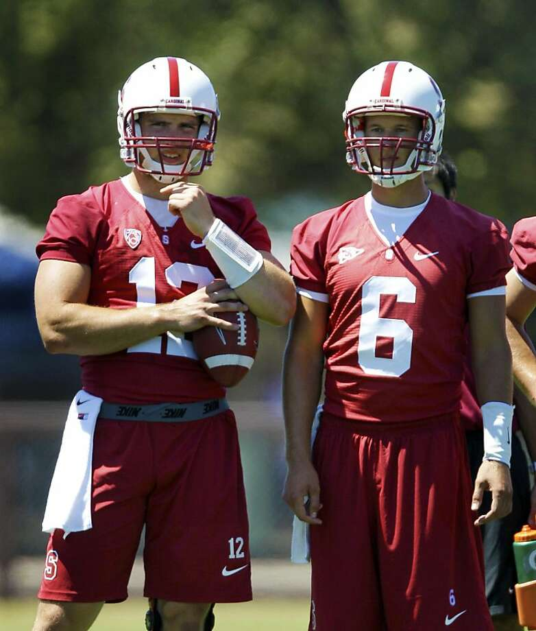 In this photo taken Aug. 8, 2011, Stanford quarterback Andrew Luck, left, and backup quarterback Josh Nunes, right, stand on the sidelines during football practice in Stanford, Calif. Nunes, Robbie Picazo and Brett Nottingham are competing for the backup spot behind Heisman Trophy favorite Andrew Luck, who turned down being the NFL draft's top pick to stay at Stanford. (AP Photo/Jeff Chiu) Photo: Jeff Chiu, AP
